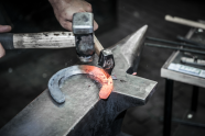 Blacksmith forming a horseshoe